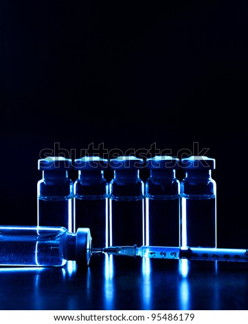 Vials of medications. Dark blue. MANY OTHER PHOTOS OF VIALS, SYRINGES IN MY PORTFOLIO - stock photo