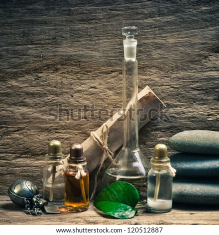 Vials of perfume oils in old fragrance lab - stock photo