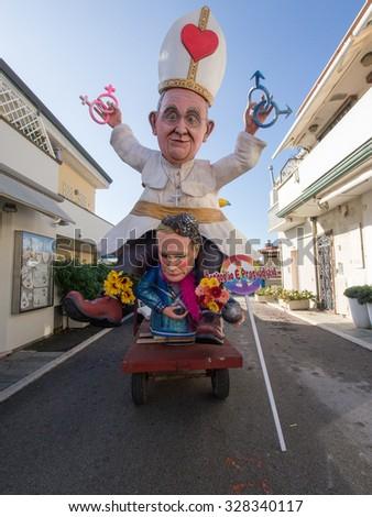 VIAREGGIO, ITALY - FEBRUARY 2:   allegorical float of pope Bergoglio and  Putin at Viareggio Carnival held February 2, 2015 - stock photo