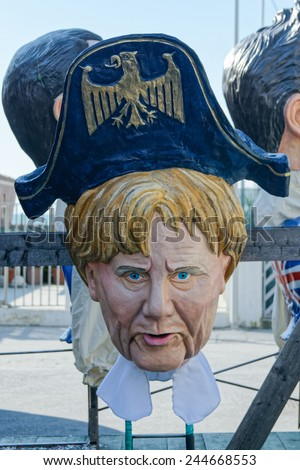 VIAREGGIO, ITALY - FEBRUARY 2:   allegorical mask of prime minister Angela Merkel at Viareggio Carnival held February 2, 2013 - stock photo