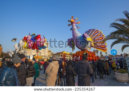 VIAREGGIO, ITALY - FEBRUARY 12: Festival, the parade of carnival floats with dancing people on streets of Viareggio. February 12, 2012, taken in Viareggio, Italy - stock photo