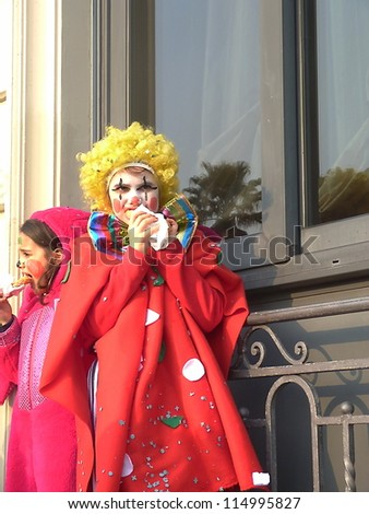 VIAREGGIO, ITALY - MARCH 4 An undefined child in carnival mask at the parades on the promenade during the famous annual Italian Carnival of Viareggio on march 4, 2012 in Viareggio, Italy - stock photo
