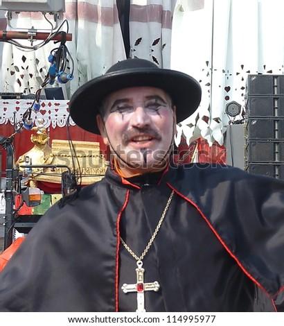 VIAREGGIO, ITALY - MARCH 4 An undefined man in carnival mask at the parades on the promenade during the famous annual Italian Carnival of Viareggio on march 4, 2012  in Viareggio, Italy - stock photo