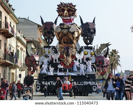 VIAREGGIO, ITALY - MARCH 4 Carnival float at the parades on the promenade during the famous annual Italian Carnival of Viareggio on march 4, 2012 in Viareggio, Italy - stock photo