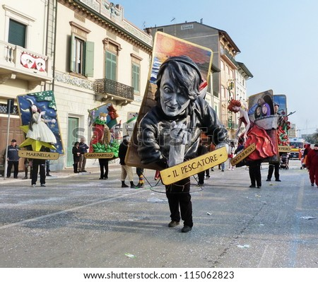 VIAREGGIO, ITALY - MARCH 4: Detail of carnival float at the parades on the promenade during the famous annual Italian Carnival of Viareggio on march 4, 2012 in Viareggio, Italy - stock photo