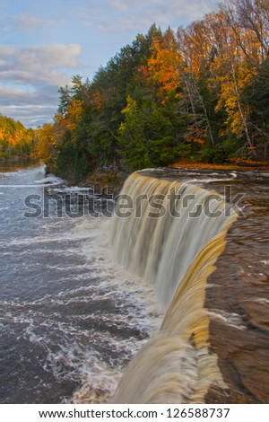 Vibrant autumn landscape with waterfall, vertical - stock photo