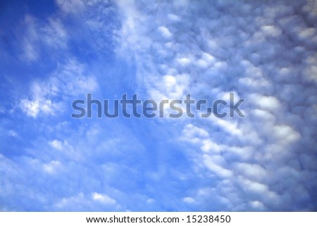 Vibrant blue skies and white cloud - stock photo