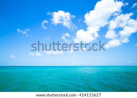 Vibrant color image of tropical ocean and sky - stock photo