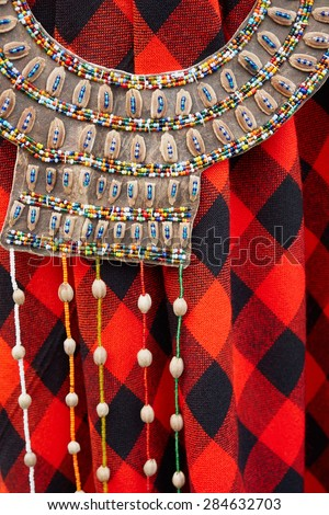 Vibrant colorful handmade typical folk African ethnic necklaces                                 - stock photo