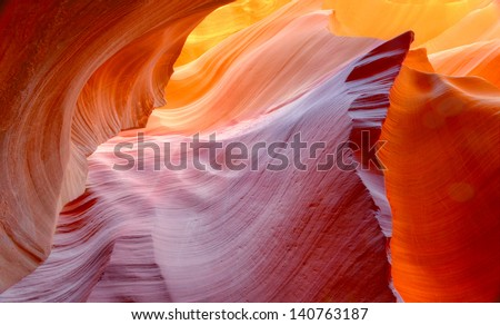vibrant colors of eroded sandstone rock in slot canyon, antelope valley, page, arizona, usa. red rock wave eroded - stock photo