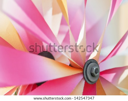Vibrant colors on a colorful pinwheel. - stock photo