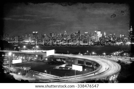 vibrant grunge night time nyc cityscape,advert space - stock photo