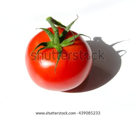 Vibrant organic vine ripe tomatoes in the sunshine isolated on a white background - stock photo