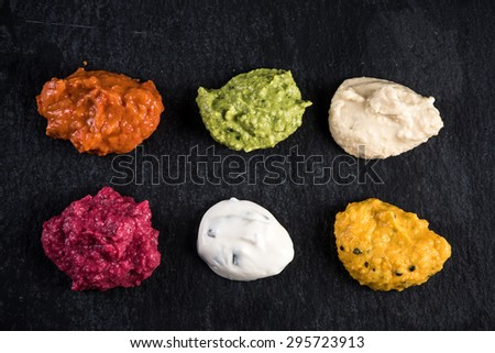 Vibrant vegetables dip selection, food background - stock photo