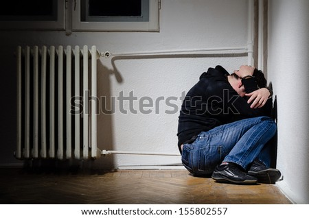Victim male having his hands tight with chains - stock photo