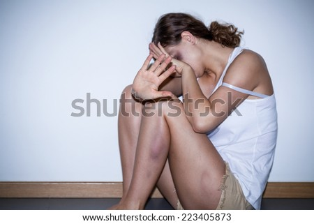 Victim of domestic violence covered with bruises - stock photo