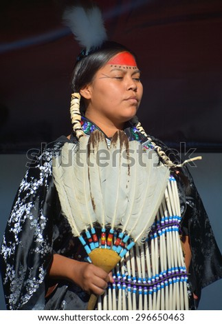 VICTORIA BC CANADA JUNE 24 2015: Unidentified Native Indian woman in traditional costume. First Nations in BC constitute a large number of First Nations governments and peoples in the province of BC - stock photo