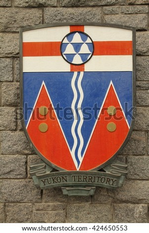 VICTORIA,BC,CANADA,MAY 21 2016: Coat of arms of yukon terrirory  is the westernmost and smallest of Canada's three federal territories. Whitehorse is the territorial capital and Yukon's only city. - stock photo
