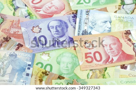 Victoria BC - Monday, March 3, 2014: Background shot of Canadian banknotes, Canadian banknotes are the banknotes or bills of Canada, photographed in Victoria, BC, Canada. - stock photo