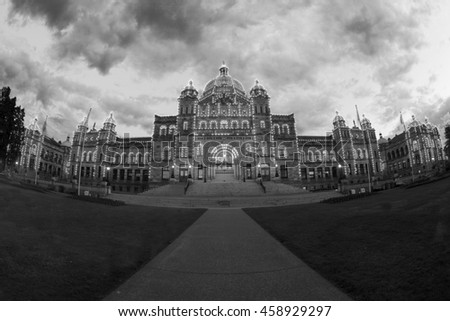 VICTORIA, CANADA - JUN 21 2016: Night view of the Parliament House Downtown. Tourists strolling the causeway. This building is the destination of many tourist attractions and recreational activities. - stock photo