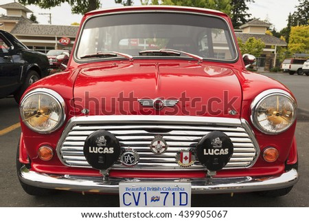 VICTORIA CANADA  - JUNE 13, 2016: A Mini Cooper vintage car on display. The Mini is made by BMC and its successors from 1959 until 2000. The original is considered a British icon of the 1960s - stock photo