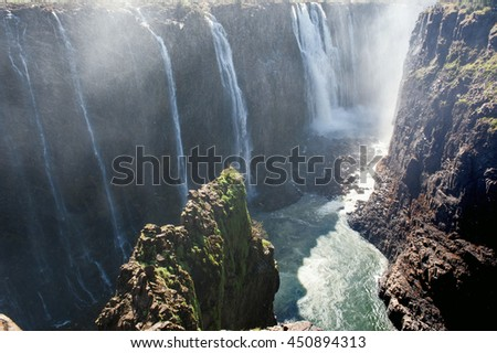 Victoria Falls on Zambezi River, border of Zambia and Zimbabwe. Africa   - stock photo