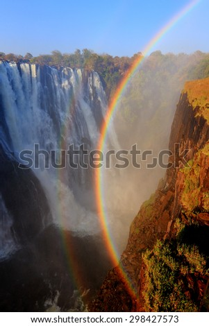 Victoria Falls sunset with rainbow, Zambia - stock photo