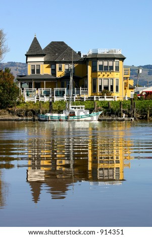 Victorian house on Rivers edge - stock photo
