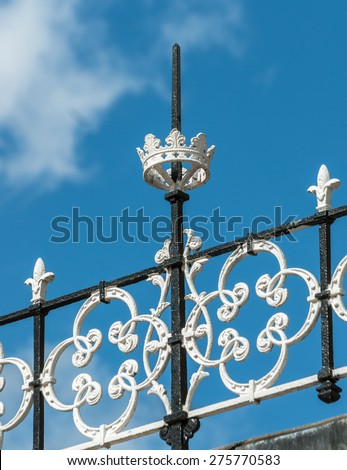 Victorian iron railings around the roof of the  Pavilion gardens building, Buxton. - stock photo