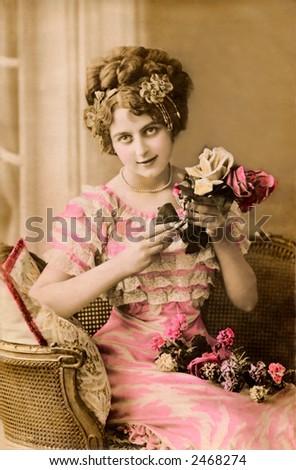 Victorian Valentine Portrait - a 1913 hand-tinted photograph - stock photo