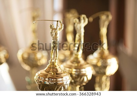 Victorious cups on golf. Cups of winners on golf. Game golf. - stock photo