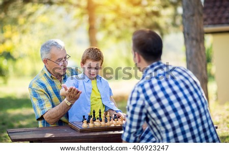 victory in chess game at park - stock photo