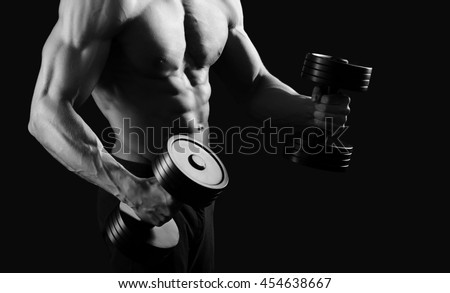 Victory or nothing. Monochrome cropped sot of a shirtless man with sexy muscular body working out shirtless pumping iron copyspace  - stock photo