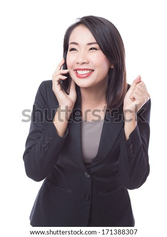 Victory young cheerful business woman with phone - stock photo