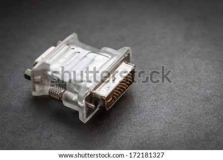 Video adapter on a dark background. Selective focus with shallow depth of field. - stock photo