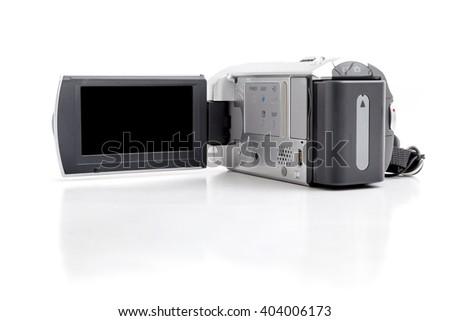 Video camcorder with screen opening on white background. - stock photo