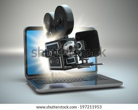 Video concept. Retro camera and  laptop. 3d - stock photo