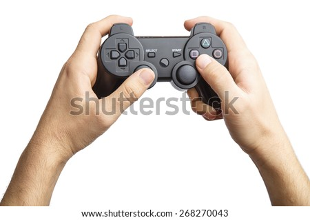 Video game console controller in gamer hands.Game controller in hand isolated on white background. Alpha - stock photo