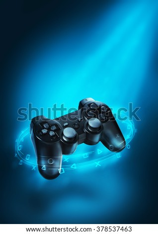 Video game controller and blue light. Playing games background. Creative art and design. - stock photo