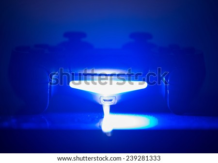 video game controller in blue light. concept about home entertainment - stock photo