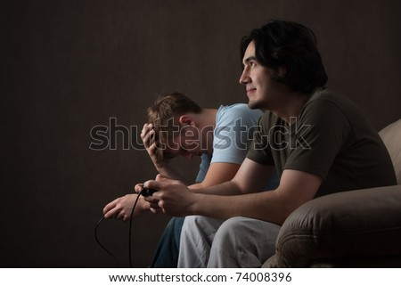video game winner and loser on gray background - stock photo