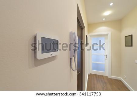 Video intercom display near the entrance door - stock photo
