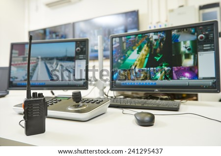 video monitoring surveillance security system equipment with portable radio transmitter - stock photo