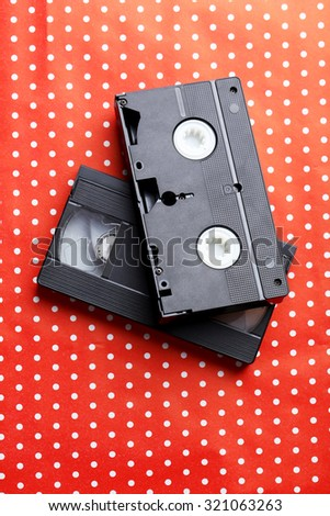 Videocassette on the red background - stock photo