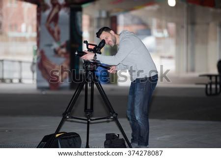 Videographer shoots the city.  - stock photo