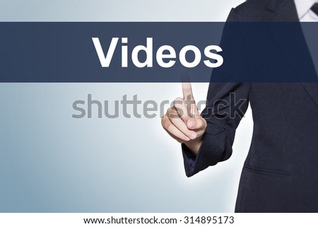 Videos Business woman pushing hand on virtual screen for e-commerce background - stock photo