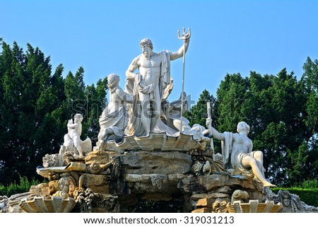 VIENNA - AUGUST 10 : Neptune Fountain at Schonbrunn Palace at 21 August 2015 in Vienna, Austria. Schonbrunn is the former home of the Habsburgs. - stock photo