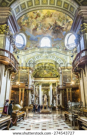 VIENNA, AUSTRIA - APR 24, 2015:  books in the beautiful Austrian National Library in Vienna, Austria. Est in 18th century, the largest library in Austria with 7.4 mill items. - stock photo