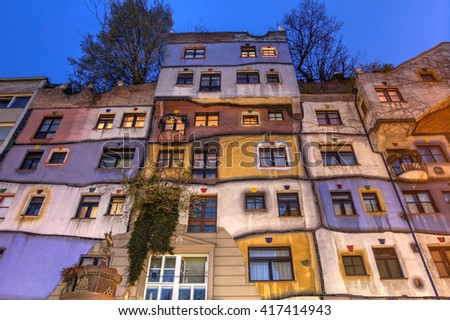 VIENNA, AUSTRIA - APRIL 2: Facade at night of the famous architectural landmark Hundertwasserhaus in Vienna, Austria on April 2nd, 2016, designed by Friedensreich Hundertwasser and Joseph Krawina. - stock photo
