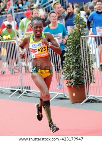 VIENNA, AUSTRIA - APRIL 10, 2016: Nyahora Rutendo finishes  the Vienna City Marathon , April 10, 2016 in Vienna, Austria. - stock photo